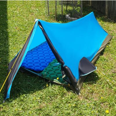 Bike packing lightweight tent on grass