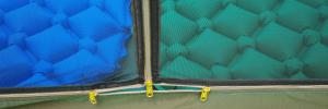 Twin sided mesh door with triple zipper