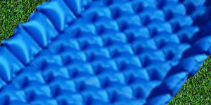 Folded up sides on blue air mattress