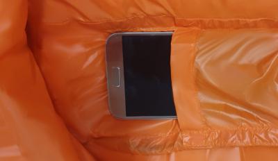 Phone pocket for phone storage in sleeping bag