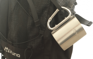 Mug with carabiner handle clipped onto backpack
